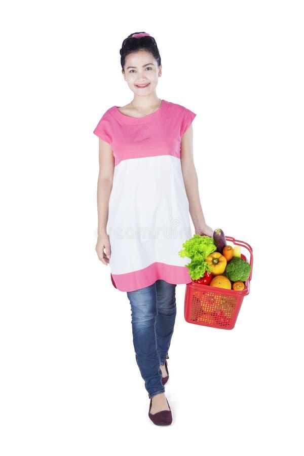 Beautiful woman carrying shopping cart royalty free stock photography