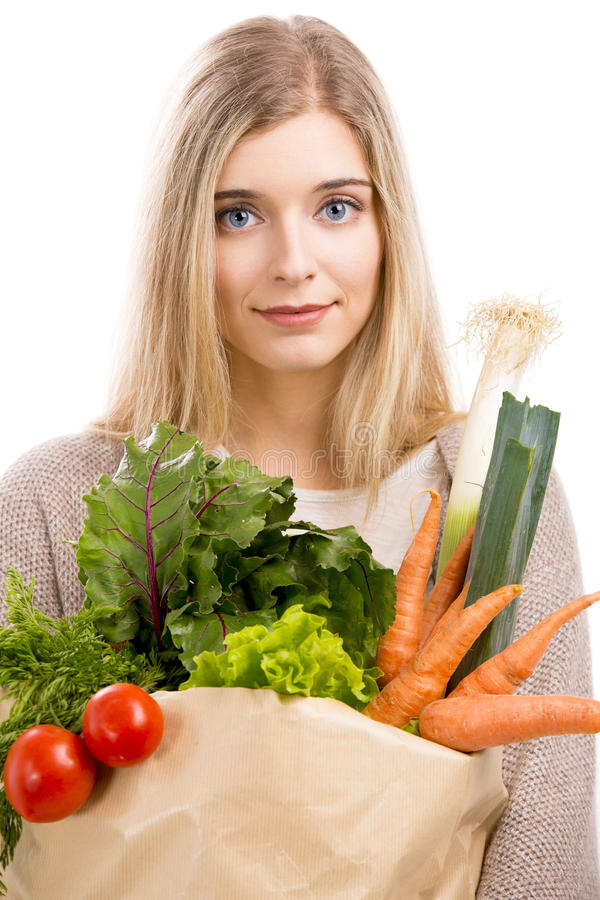 Beautiful woman carrying vegetables royalty free stock photography