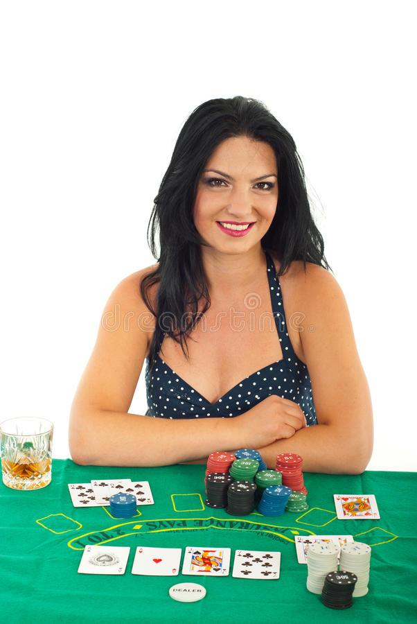 Beautiful woman at casino. Beautiful woman sitting at casino table isolated on white background stock image