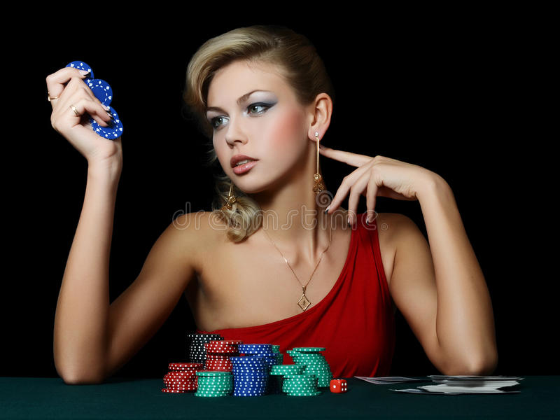 The beautiful woman with casino chips stock image