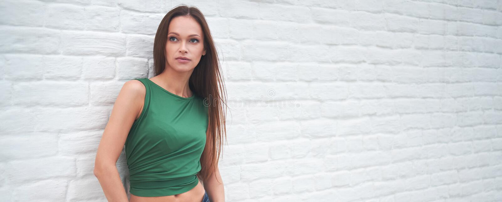 Beautiful woman in casual clothes looking away. royalty free stock images