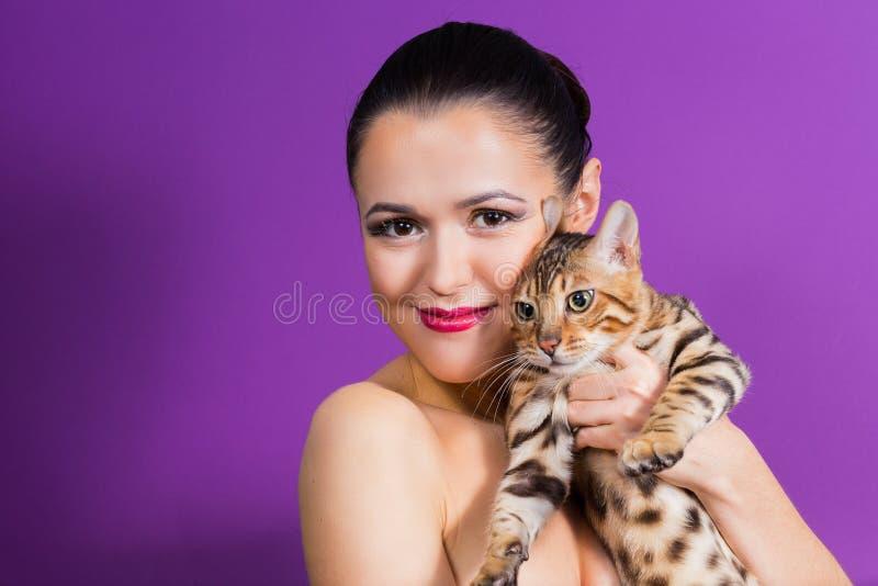 Beautiful woman with cat stock photos
