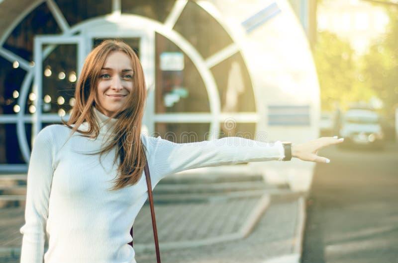 Beautiful woman catches a taxi car transport stock photos
