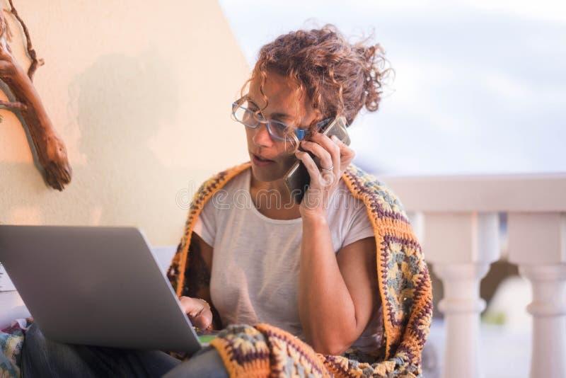 Beautiful woman caucasian working at laptop outdoor stock image