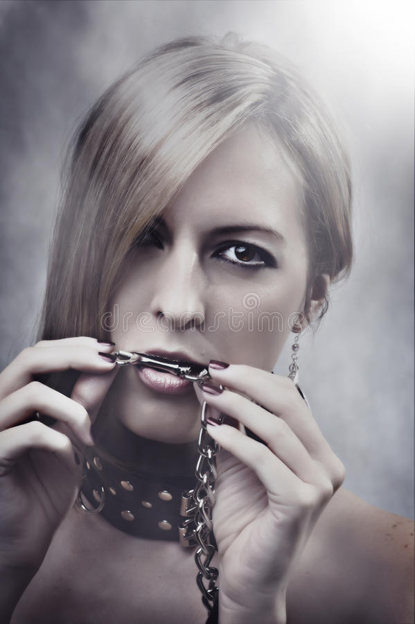 Beautiful Woman With Chain In Her Mouth Royalty Free Stock Images