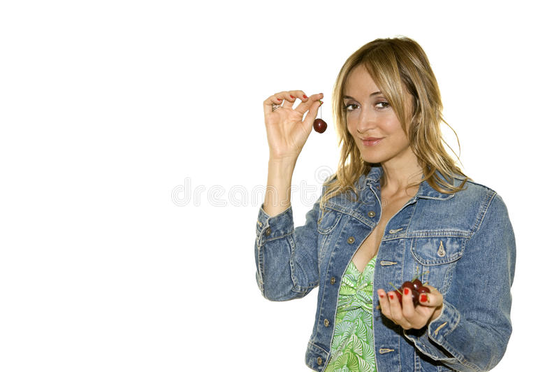 Beautiful woman with a cherry stock images