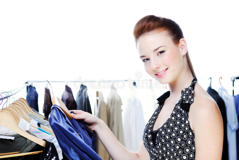 Beautiful woman choose clothes royalty free stock image