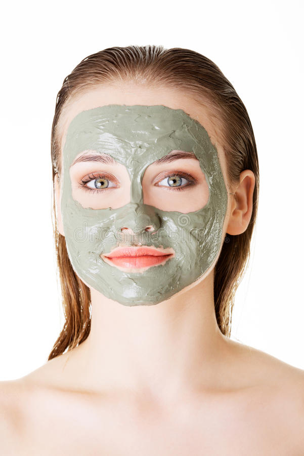 Beautiful woman with clay facial mask, isolated on white stock images