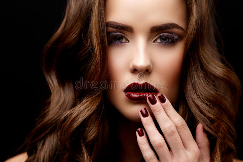 Beautiful Woman with Clean Fresh Skin and healthy curly hair stock photography