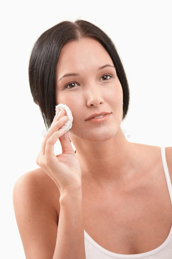 Beautiful woman cleaning face royalty free stock image