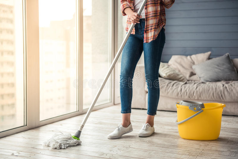 Beautiful woman cleaning house stock photo