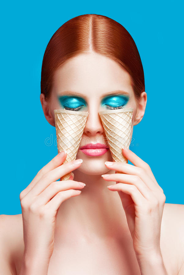 Beautiful woman close up with a ice cream cones, high-quality beauty royalty free stock photography