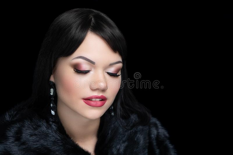 Girl in a black mink coat stock photo