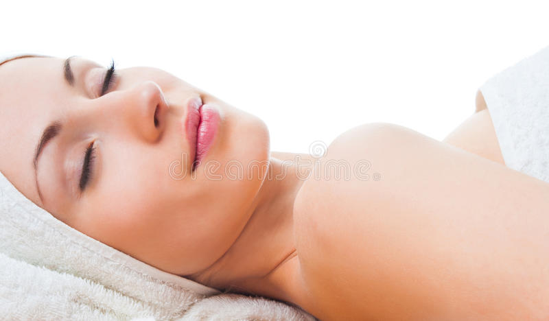 Beautiful woman with closed eyes in spa royalty free stock photo
