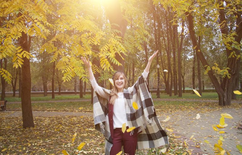 Beautiful woman in a coat park autumn leaves royalty free stock photos