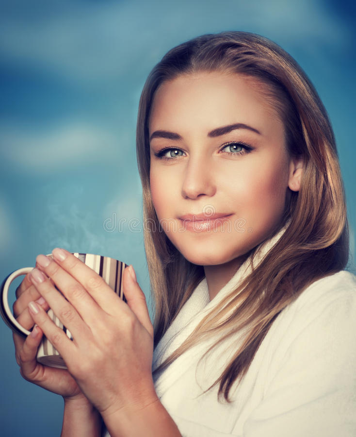 Beautiful woman with coffee cup royalty free stock image