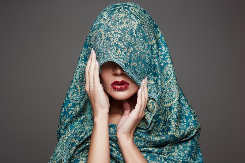Beautiful woman in color veil. red lips girl. Fashion islamic style woman stock image