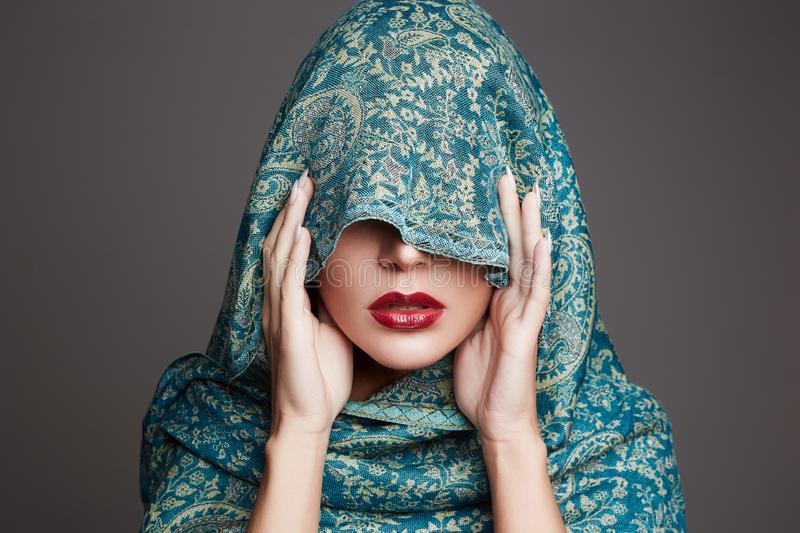 Beautiful woman in color veil. red lips girl. Fashion islamic style woman royalty free stock image