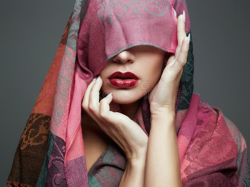 Beautiful woman in color veil. red lips girl. Fashion islamic style woman royalty free stock photos
