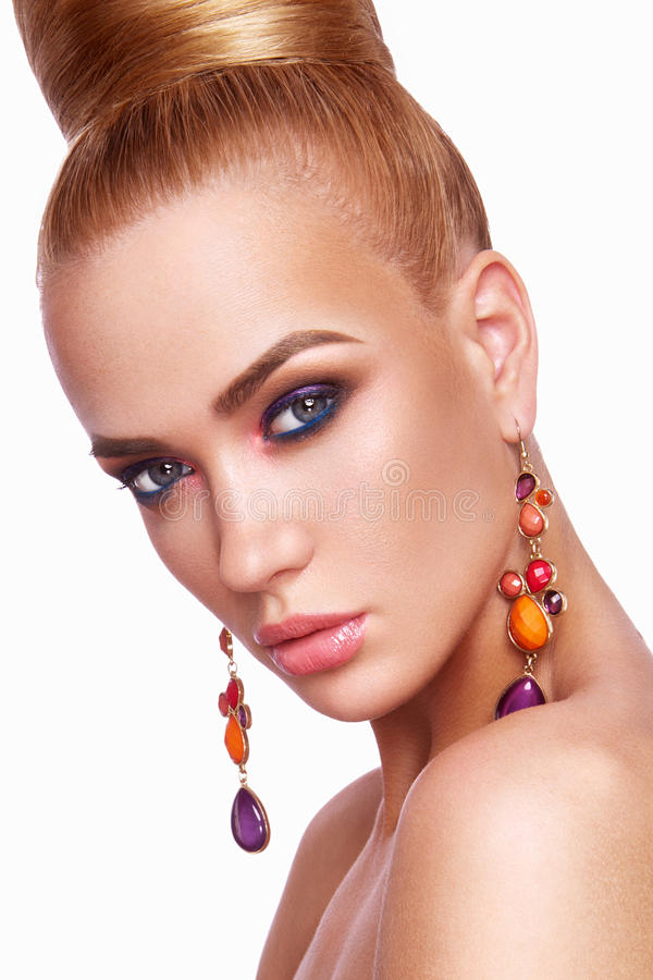 Beautiful woman with colored makeup. stock image