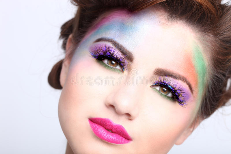 Beautiful Woman With Colorful Creative Cosmetics. Woman With Colorful Creative Cosmetics on White stock photo