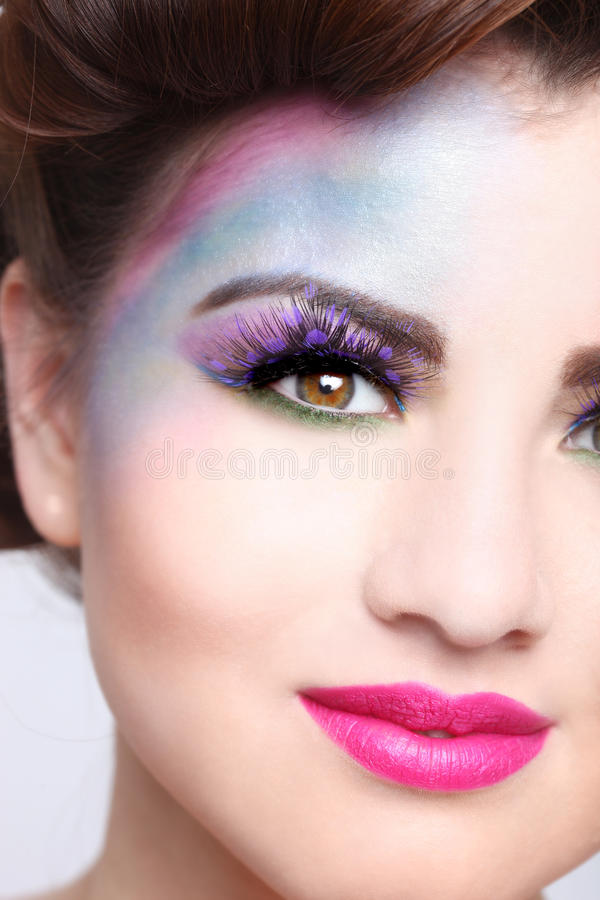 Beautiful Woman With Colorful Creative Cosmetics. Woman With Colorful Creative Cosmetics on White stock photos