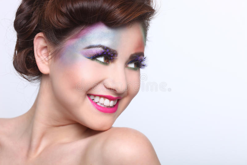 Beautiful Woman With Colorful Creative Cosmetics royalty free stock image