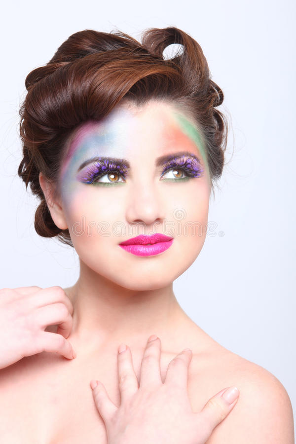 Beautiful Woman With Colorful Creative Cosmetics stock photos