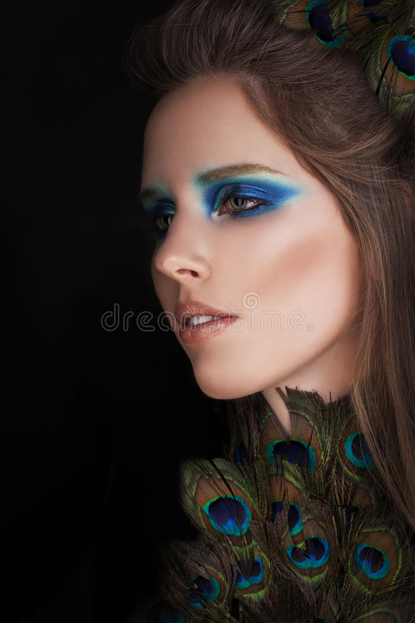 Beautiful Woman with Colorful Fashion Makeup stock photo