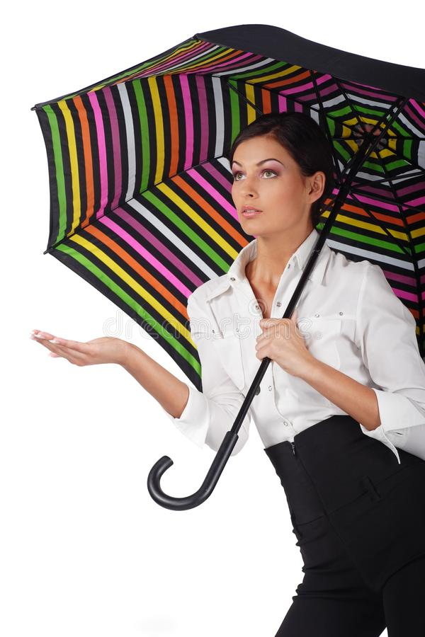 Beautiful woman with colourful umbrella on white royalty free stock photography