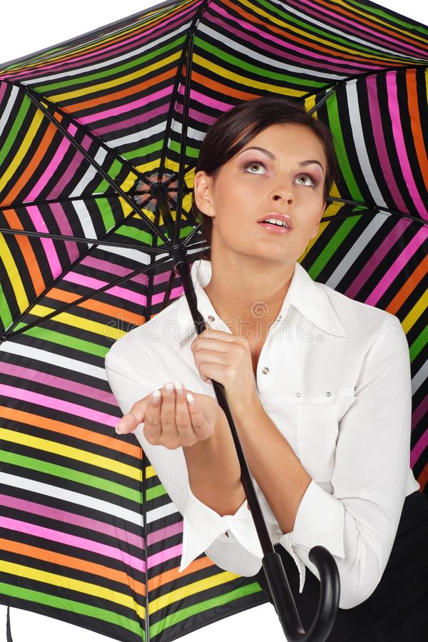 Beautiful woman with colourful umbrella on white b royalty free stock photography