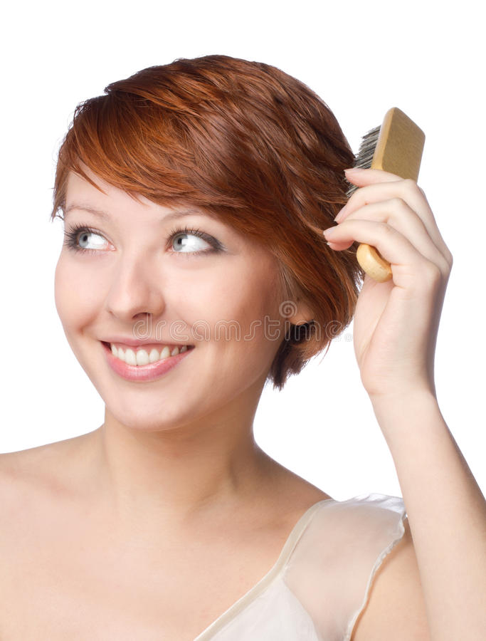 Beautiful woman with comb on her hands stock image