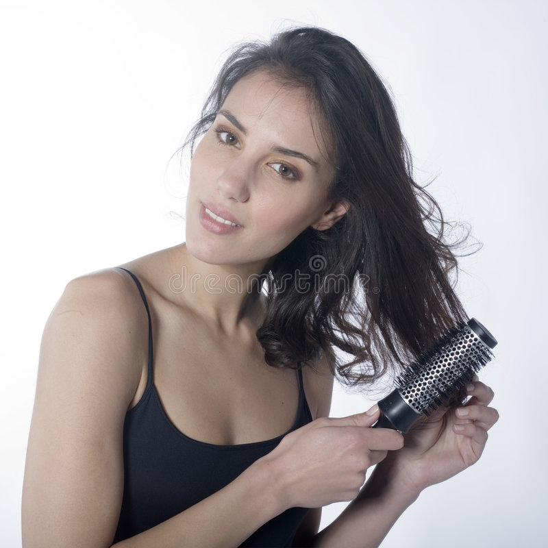 Download Beautiful Woman Combing Her Hair Stock Image - Image: 7642141