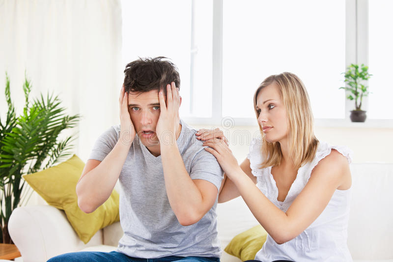 Download Beautiful Woman Comforting Her Stressed Boyfriend Stock Photo - Image: 16484078
