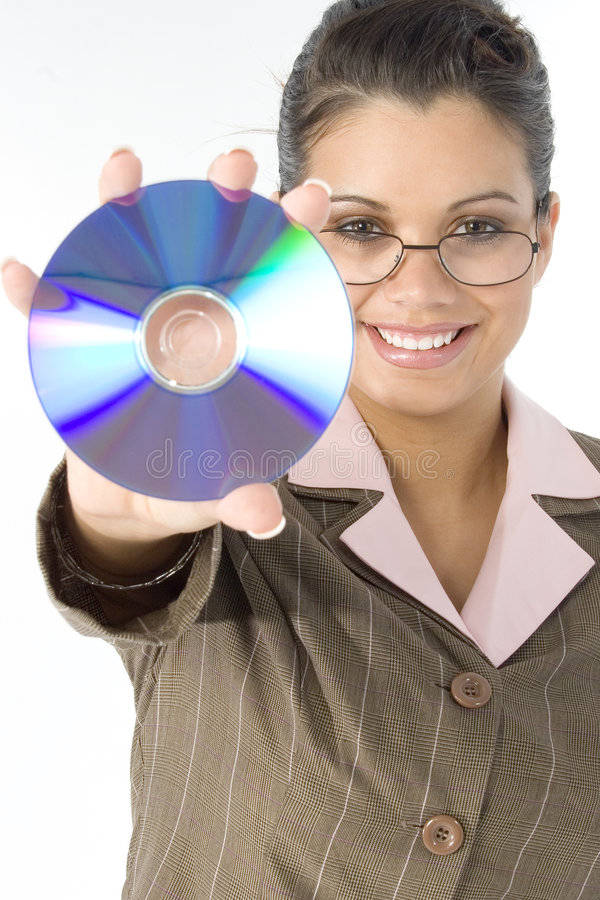 Beautiful Woman with Compact Disc in Hand. Beautiful Hispanic woman holding up compact disc. Focus on face. Shot in studio royalty free stock photos