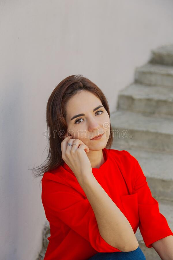 Beautiful woman on a concrete staircase. Portrait of a happy woman. royalty free stock photo
