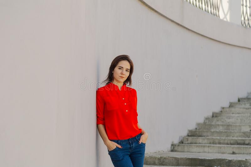 Beautiful woman on a concrete staircase. Portrait of a happy woman. royalty free stock photography