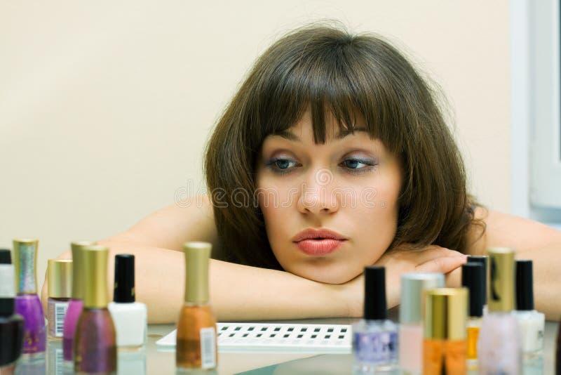 Beautiful woman with cosmetics. royalty free stock photo
