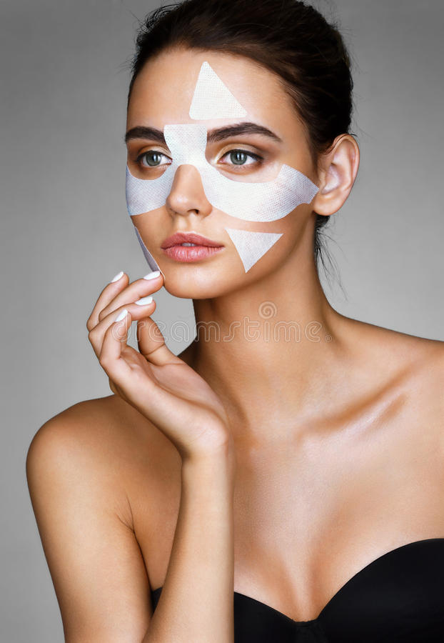 Beautiful woman with cotton facial mask. royalty free stock photography