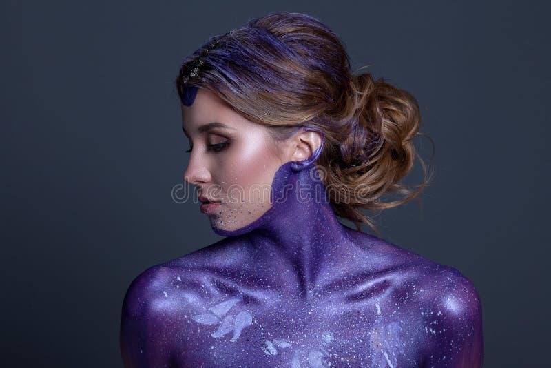 Beautiful woman with creative hair and makeup stock photo
