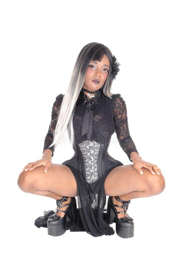 Beautiful woman crouching on floor. royalty free stock photo