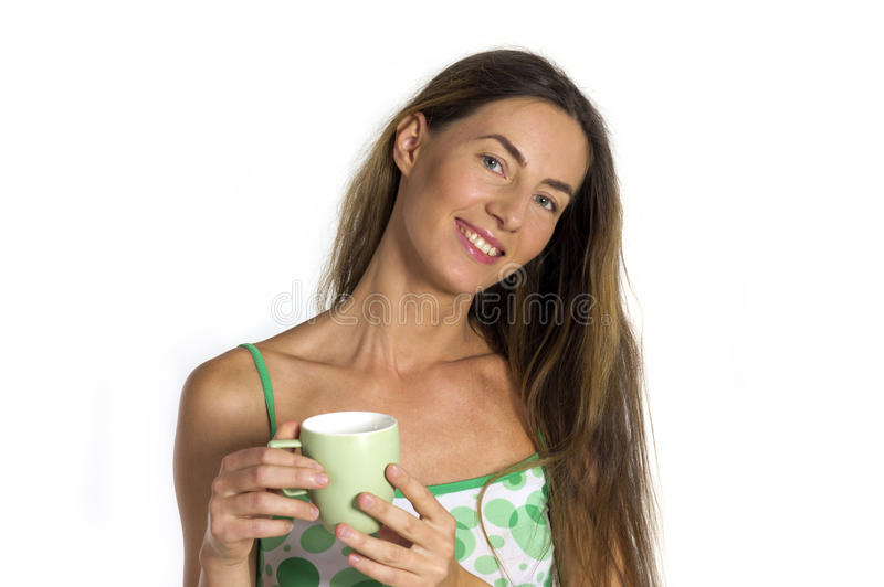 Beautiful woman with cup in hands stock images