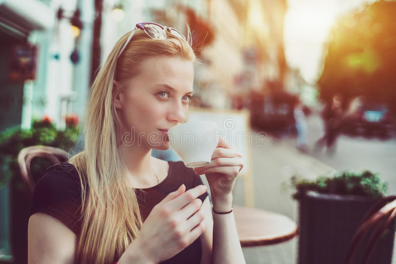 Beautiful woman with cup of tea royalty free stock image