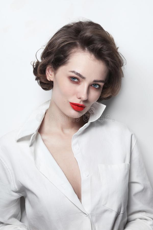 Beautiful woman with curly hair and red lips royalty free stock photography