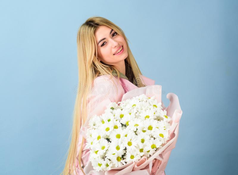 Beautiful woman with daisy flower bouquet. mothers day. Spring and summer. happy birthday present. Marguerite. florist. In flower shop. womens day. Pretty girl royalty free stock photos