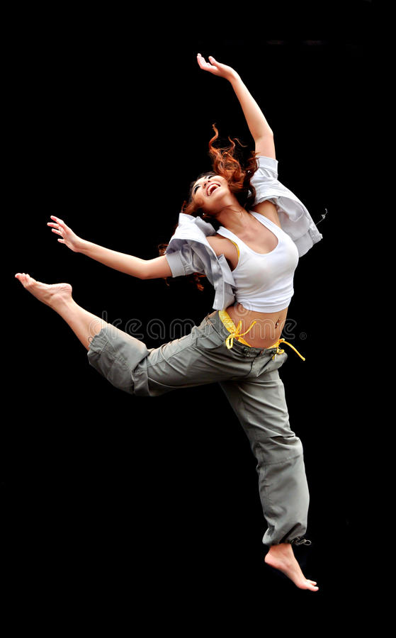 Beautiful woman dancing on dark background royalty free stock photography