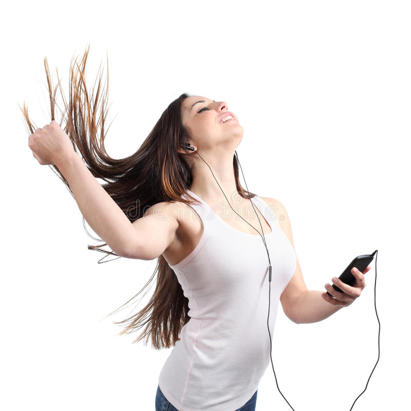 Beautiful woman dancing and listening to the music with headphones royalty free stock image