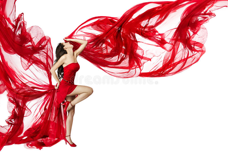 Woman Red Dress flying on wind, Dancing on White. Woman in Red Dress flying on wind, Dancing over white background, Fashion Beauty Model, Posing with Red Cloth