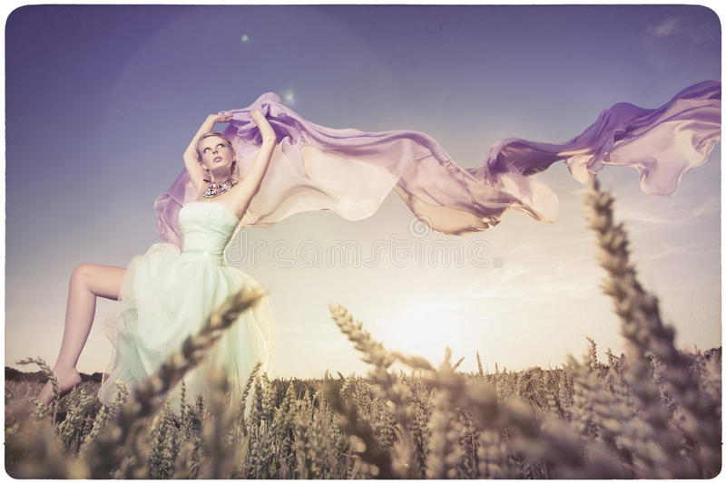 Beautiful woman dancing in the sundown. Background on old, yellowed paper royalty free stock photos