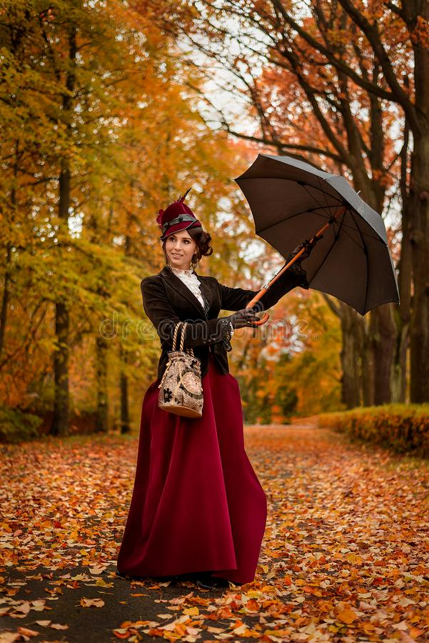 Beautiful woman dancing with umbrella in the park royalty free stock photography
